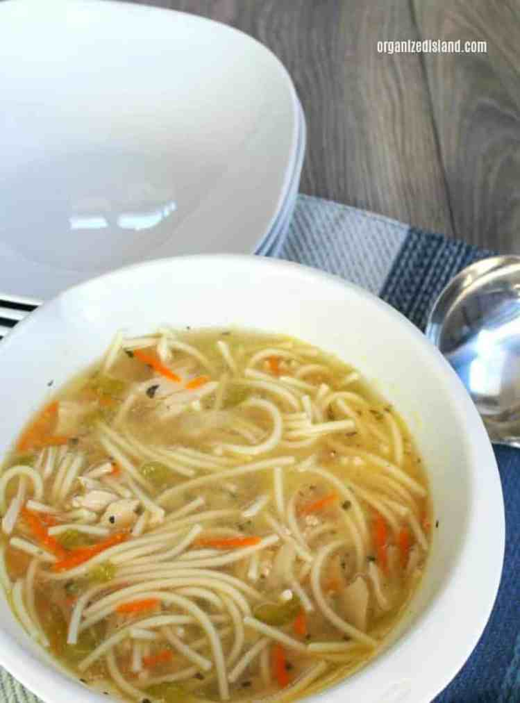 bowl of chicken soup with spaghetti noodles