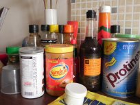 Sauce bottles, peanut butter, protien supplement, worcestershire sauce