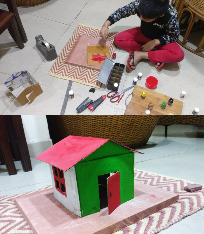 Advay creating his cardboard Mera-Merir house