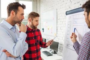 Three men planning a website