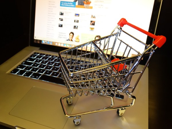 Little shopping cart on top of a laptop.
