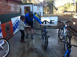 Delamere family cycling - cleaning the bikes