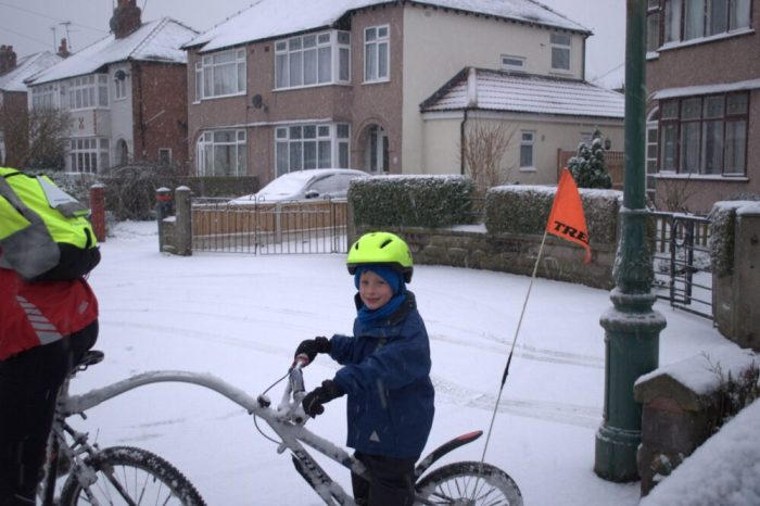 Setting off on the bike ride to school in the snow