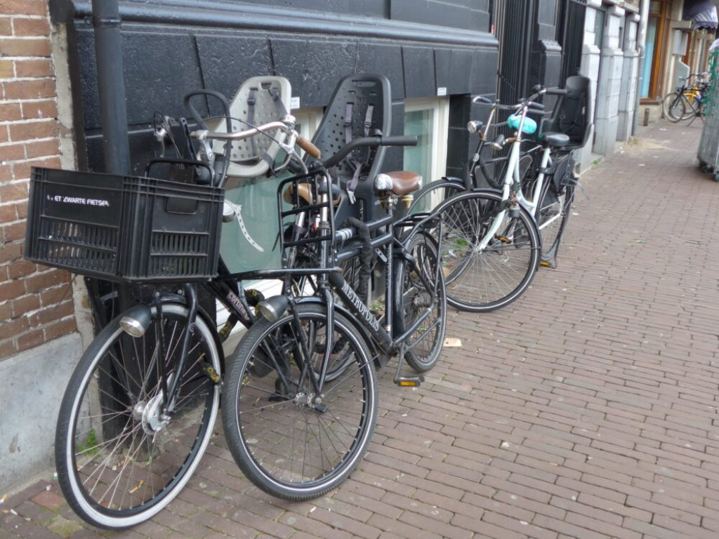 Photo of Dutch bikes with front and back kids bike seats - Amsterdam, Holland