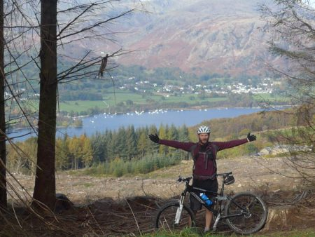 Mountain biking during the autumn at Grizedale Forest, Cumbria