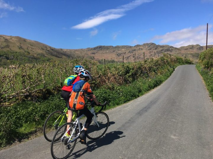 Kids road bikes being ridden the the Lake District - the Islabikes Luath and the Frog Road bike