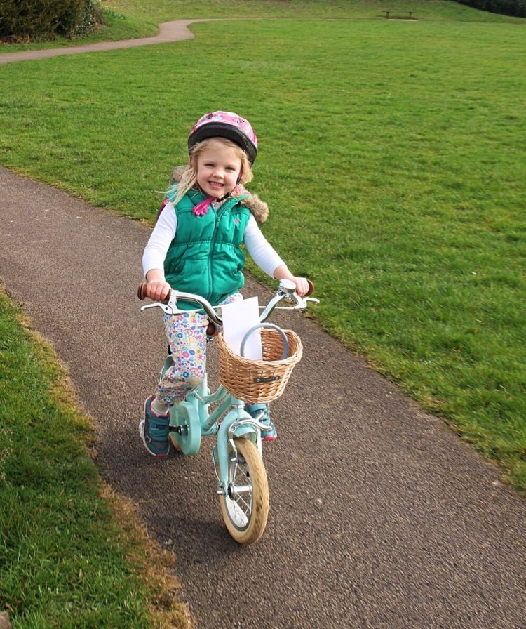 best bike for my child - little girl on first pedal bike