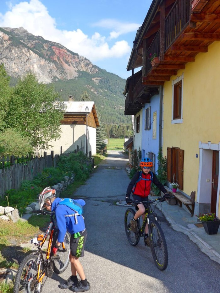 Family cycling in the Vallée de la Clarée in the French Alps - boys getting ready to ride