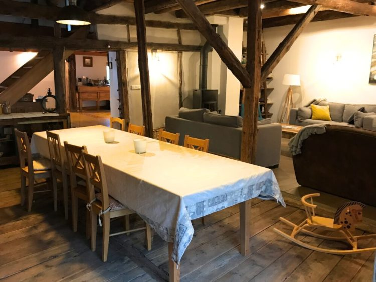 The lounge and dining area at family friendly chalet Maison Amalka in the French Alps close to Montgenèvre, Briançon and Col du Lautaret, France