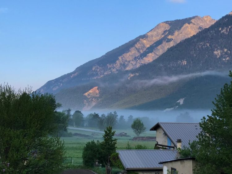 Cycling with kids in the french alps - early morning view
