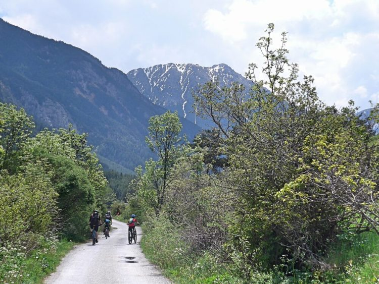 Family cycling in the Vallée de la Clarée in the French Alps -the views are perfect!