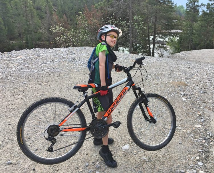 Family cycling in the Vallée de la Clarée in the French Alps - our 8 year old strugged to lift his heavy bike