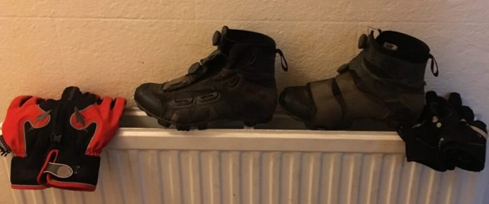 Drying the wet cycle shoes and gloves on the radiator during the Lands End to John O'Groats attempt New Year 2017/18