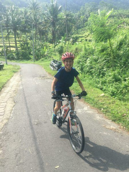 Tom, aged 9, cycling in Bali