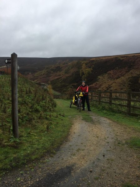 Cycling the Trans Pennine Trail at Woodhead with children in a trailer and on bikes