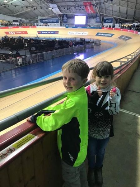 Kids watching track cycling at the velodrome