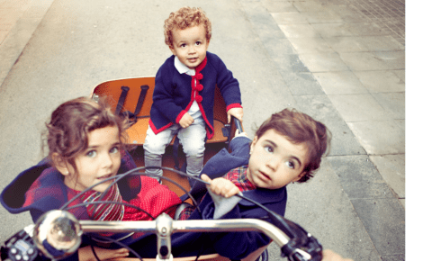 Best cargo bike for your family - three children in cargo bike
