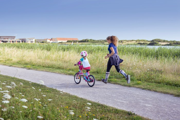 Jogging with your child as they cycle