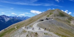 Cyclists at Col Basset, then the road heads higher