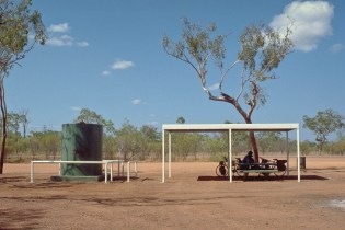 shady road stop in the outback with water tank