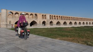 Cross one of the old bridges in Isfahan and continue cycling along the south bank of the river