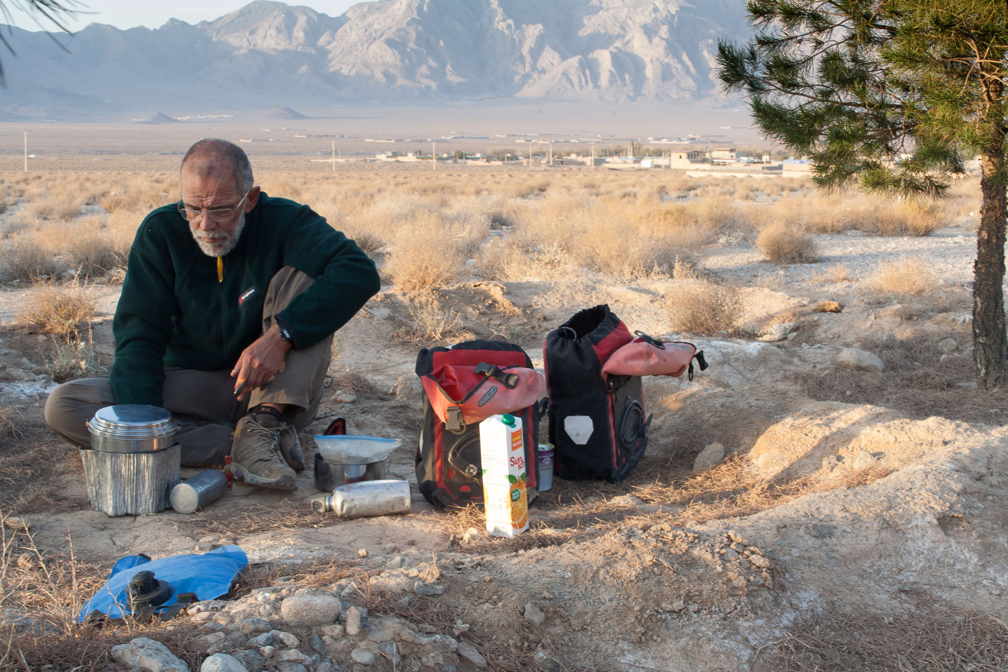 Cooking a spaghetti and veggies meal while free camping along the Yazd to Shiraz road