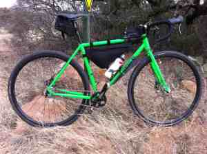 A frame, seat, and top tube bag make it easy to carry extra water, snacks, repair supplies, and layers of removed clothing on a cyclocross bike.