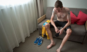 Bradley Wiggins in his hotel room after winning the yellow jersey.