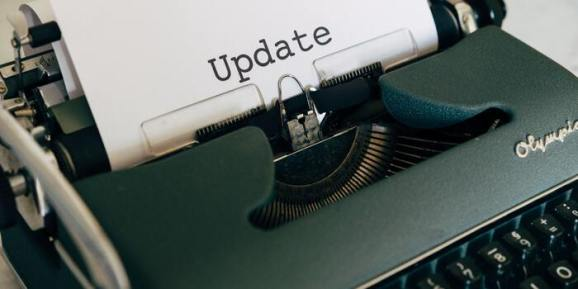 Old typewriter has typed the word 'Update' on paper
