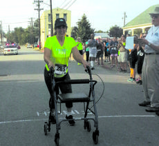 "<div class=""source"">Photo courtesy of Jeri Stracner</div><div class=""image-desc"">Kristen Crawford crosses the finish line to the sound of cheers and applause in her first ever 5K run.</div><div class=""buy-pic""><a href=""http://web2.lcni5.com/cgi-bin/c2newbuyphoto.cgi?pub=081&amp;orig=viewpoint_5krun.jpg"" target=""_new"">Buy this photo</a></div>"