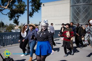 Students dressed in Halloween costumes like Freddy Kruger walk through campus
