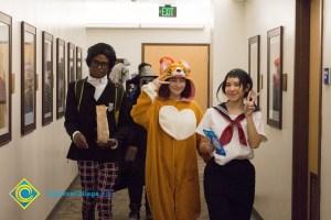 Students in Halloween costumes walking in hallway