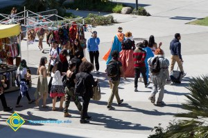 Students walking through campus in Halloween costumes