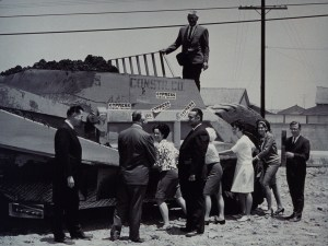 People posing with construction equipment