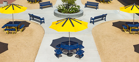 Solar-powered umbrellas on tables on campus