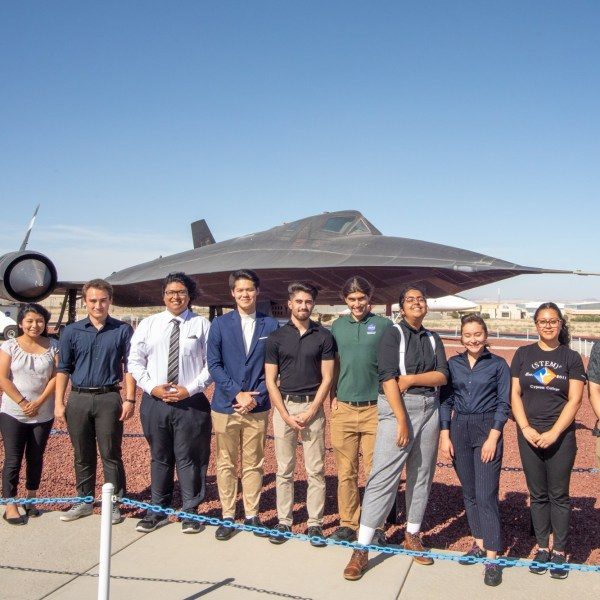 Students standing in front of aircraft