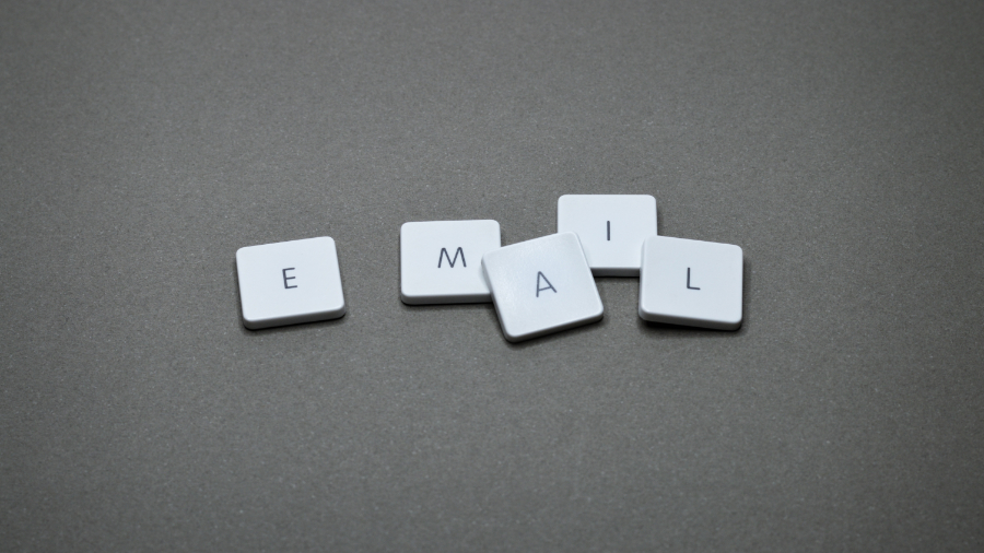 "Board game tiles that spell out ""E-Mail"""