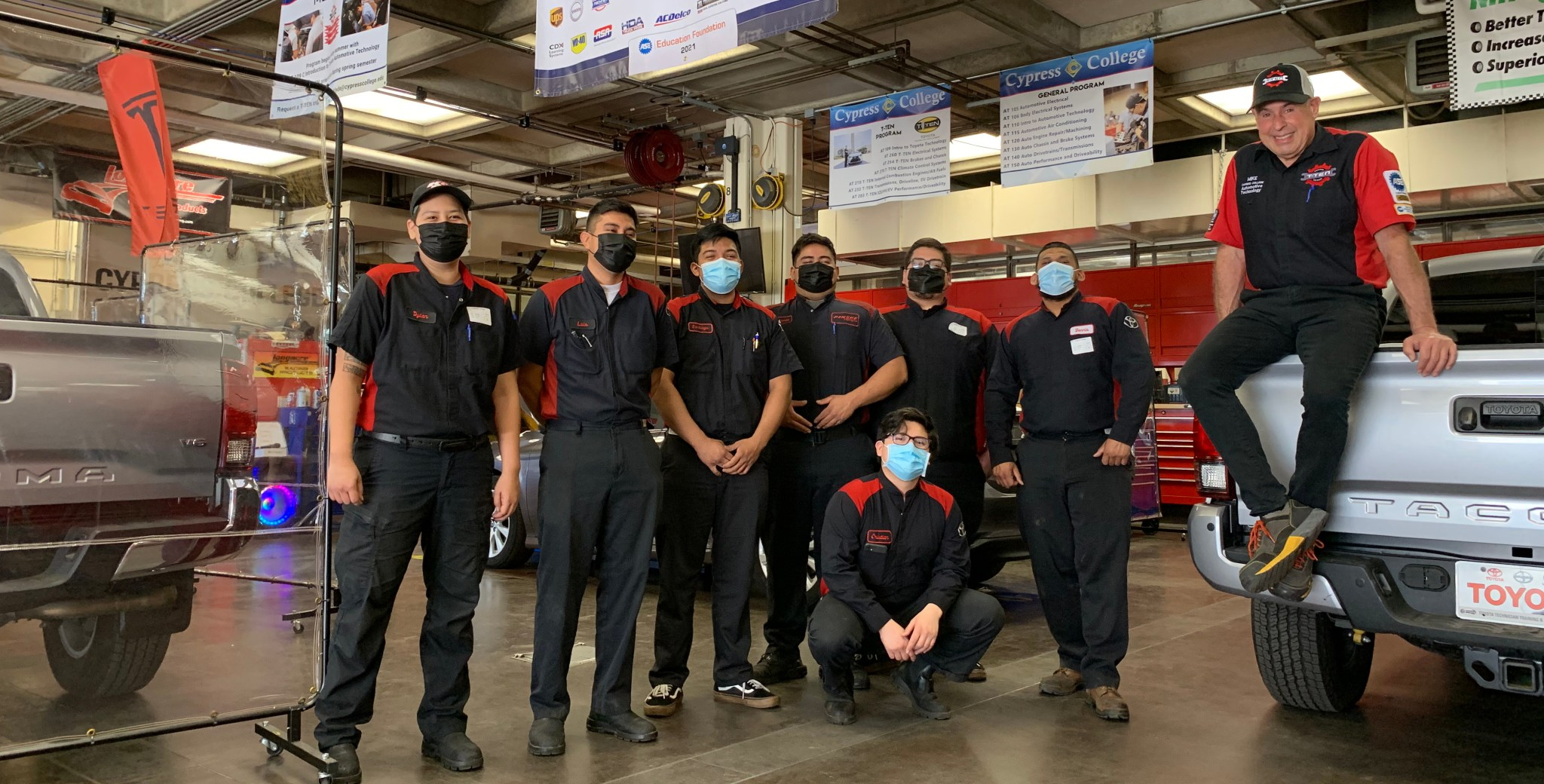 Automotive Technology students on campus in the garage working on the Toyota T-TEN program.