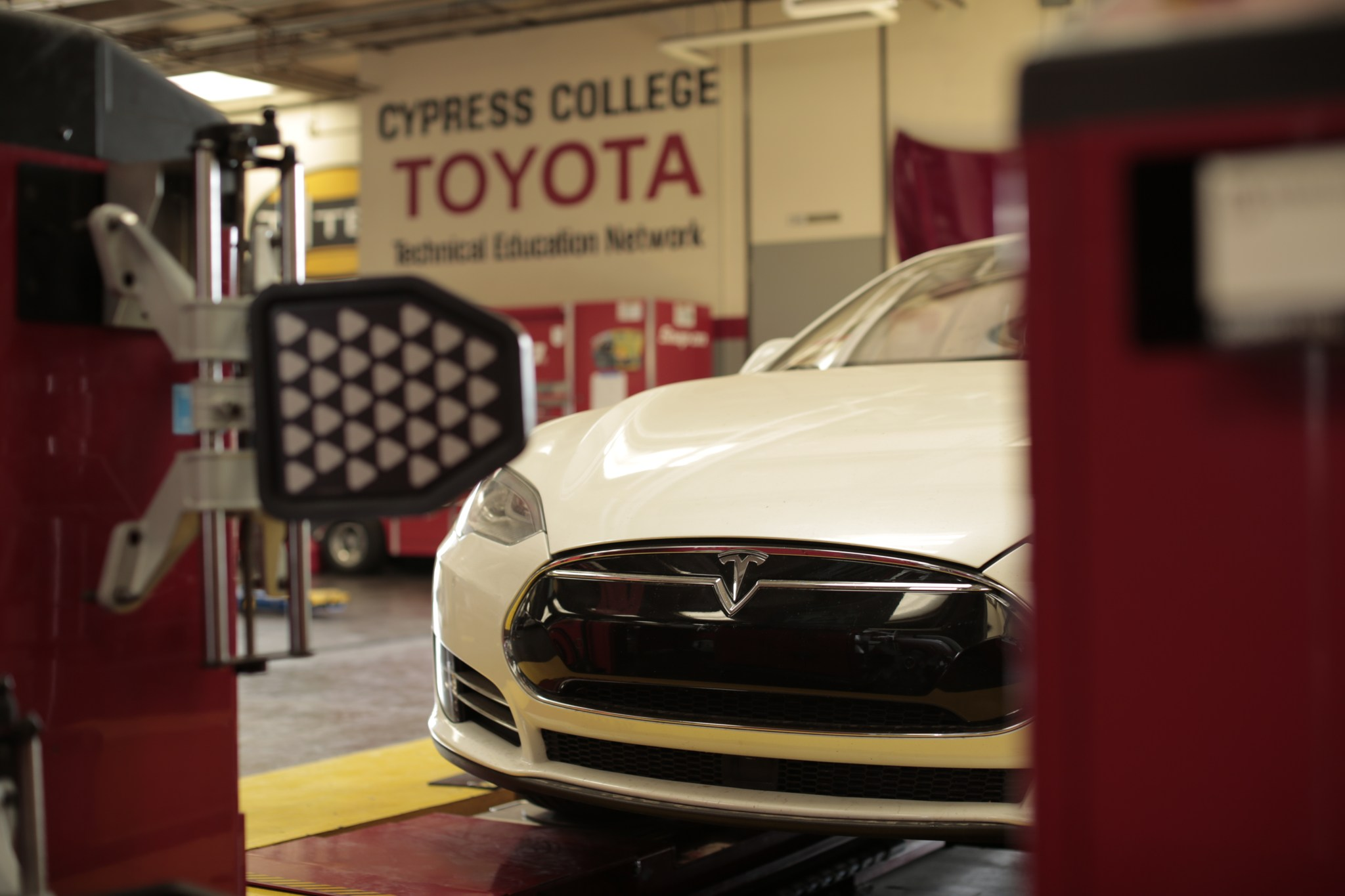 A car waits to be serviced in the Automotive Technology department