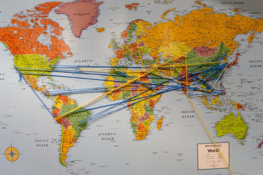 Map of the world with strings going to various places
