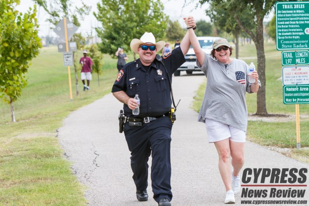 "More than 100 supporters showed their dedication to keep the memory of Darren Goforth alive at Sunday's ""United we Goforth"" memorial walk at the park named after him. Deputy Goforth was murdered in Copperfield Aug. 28, 2015. You can find our more information and learn how to support the non-profit organization leading this and other events at www.facebook.com/deputymemorialfund/. (Cypress News Review photo by Creighton Holub)"