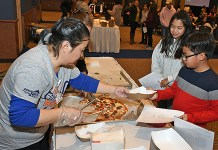 Visitors survey food offerings at the Annual Food Tasting event at the Berry Center in January 2018. The event returns on Feb. 7, welcoming community members to sample the latest products in school cafeterias. (CFISD courtesy photo)