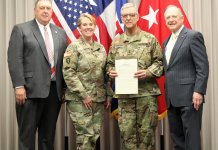 Texas State Representatives Cecil Bell (District 3) and Dan Flynn (District 2) present to Maj. Gen. Robert Bodisch, Commander, Texas State Guard, a resolution of the Texas House of Representatives of the 86th Texas Legislature congratulating Bodisch on his assumption of command of the Texas State Guard. Flynn and Bell presented the resolution during Bodisch's assumption of command ceremony at Camp Mabry, Austin, Texas, January 26, 2019. (Texas State Guard photo by Chief Warrant Officer 3 Janet Schmelzer)