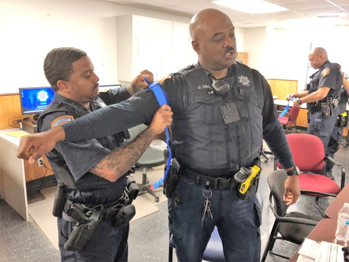 "Harris County Sheriff's deputies practice applying tourniquets during a recent ""Stop the bleed"" training with the Cypress Creek EMS. (CCEMS courtesy photo)"