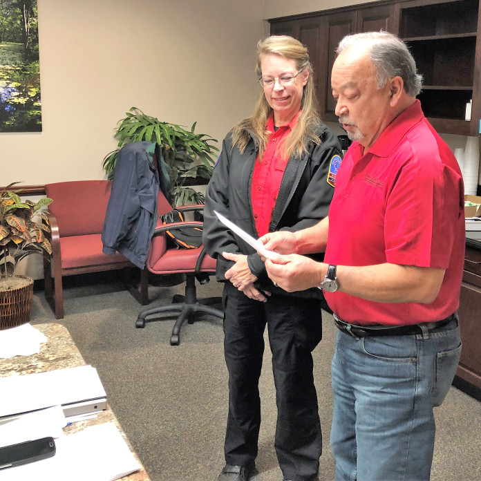 Katie Moore is honored by the CCEMS board as the volunteer of the month. (courtesy photo)