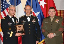 """Texas State Guard Staff Sgt. Gregory Illich, 8th Regiment, Army Component, was recognized as the Texas State Guard Outstanding Non-Commissioned Officer of the Year 2018 and awarded the Texas Outstanding Service Medal by Texas State Guard Commander Maj. Gen. Robert Bodisch, and Command Sgt. Maj. Bryan Becknel during a ceremony held at the Texas State Guard holiday gala in San Marcos, Texas, December 8, 2018. He was also recognized as the Texas State Guard Army Component Outstanding Non-Commissioned Officer of 2018 and received """"Sgt. Maj. Hiram J. Williamson Award for Service Excellence."""" (Texas State Guard photo by Cpl. Shawn Dromgoole)"""