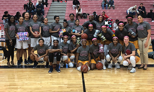 The Cypress Springs and Cypress Ranch high school girls' varsity basketball teams pose together with blankets collected to help support childhood cancer. Donations were made Jan. 29 when the teams met at Cypress Springs. A total of 153 blankets were donated to B.I.G. Love Cancer Care, an organization that provides personalized care to children with cancer as well as their families at Texas Children's Hospital and MD Anderson Children's Cancer Hospital. (CFISD courtesy photo)