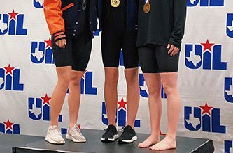 Cypress Creek High School freshman Hayden Miller (center) smiles after winning the 500-yard freestyle with a time of 4:50.13 at the UIL Swimming and Diving Class 6A State Meet. Miller was CFISD's lone medalist but among seven total top-10 finishes. She poses with Katy Seven Lakes' Beth McNeese (left) and Southlake Carroll's Natalie Whalen. (CFISD courtesy photo)