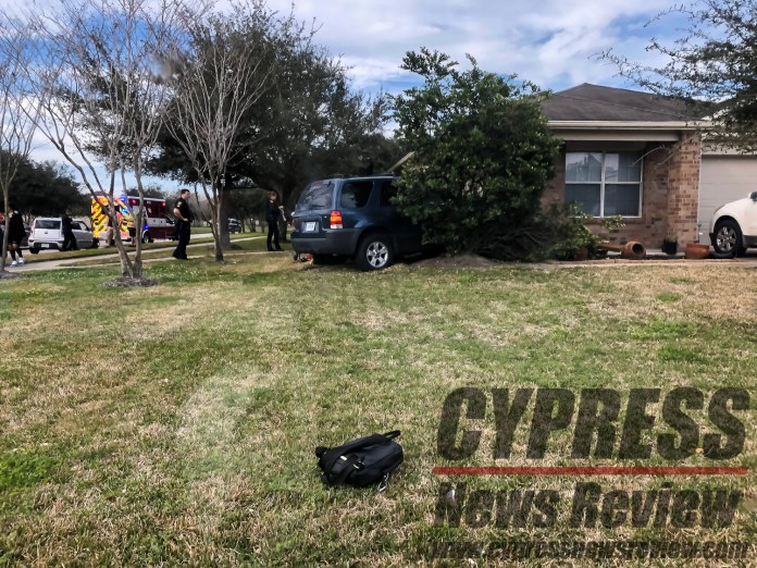 Two vehicles were involved in an incident that ended with one driving onto property at the corner of Greenhouse Road and Yaupon Mist Drive at approximately 3:30 p.m., Friday, Feb. 15, 2019. (Cypress News Review photo by Creighton Holub)