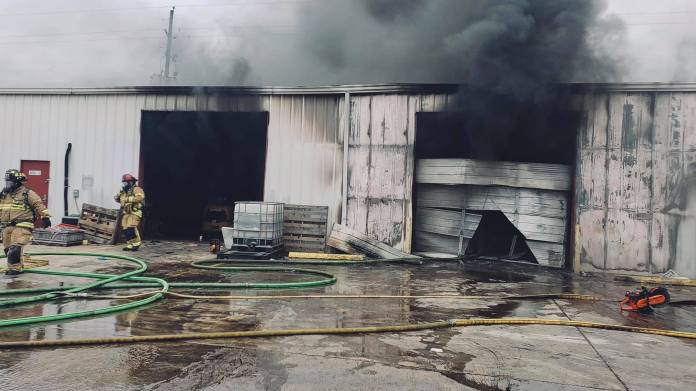 Cypress and Jersey Village firefighters battle yesterday's fire where a wall collapsed on three CFVFD firefighters at the 6000 block of Brittmoore Road. (CFVFD courtesy photo)